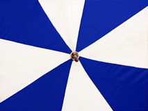 Blue and white umbrella Stock Images