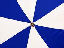 Blue and white umbrella. Umbrella, background, rain, blue, white, object, close-up Stock Images