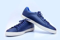 Blue and White Unisex Shoes - Sneakers. stock photo