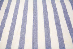 Blue and white vertical striped tablecloth Stock Photos