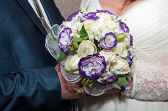 Blue and white wedding bouquet. In the hands of the bride and groom Stock Photo