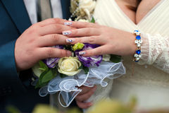 Blue and white wedding bouquet. In the hands of the bride and groom Royalty Free Stock Images