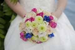 Blue and white wedding bouquet. In the hands of the bride and groom Royalty Free Stock Photo