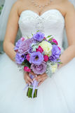 Blue and white wedding bouquet. In the hands of the bride and groom Royalty Free Stock Photos