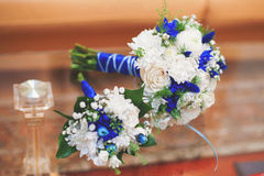 Blue and white wedding bouquet of roses, vintage toned Stock Photo