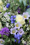 Blue white wedding flowers. Blue white flower arrangement: various flowers in different shades of blue for a wedding Royalty Free Stock Image
