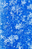 Blue white winter background from snowflakes blur Stock Photography