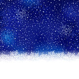 Blue white winter, Christmas background with snow flake border. White snow flake border at the bottom of a blue abstract background with blurry light dots and Royalty Free Stock Photo