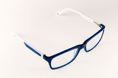 Blue-white women eyeglasses Royalty Free Stock Photography