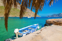Blue and white wooden boat in cosy Greek port stock images