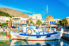 Blue-white wooden boat moored in Greek port Stock Photography