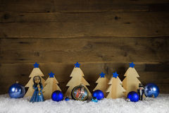 Blue and white wooden christmas background with snow for decorat Royalty Free Stock Images