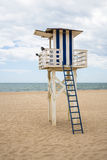 Blue and white wooden lifeguard hut on a cloudy day. At a beach Royalty Free Stock Photo
