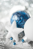 Blue and white xmas ornaments on bright holiday background Stock Image