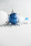 Blue and white xmas ornaments on glitter holiday background. Merry christmas card. Royalty Free Stock Photography