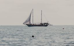 SAILING SHIP IN THE MIDDLE OF THE SEA royalty free stock image