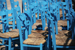 Blue wickerwork chairs Stock Photos