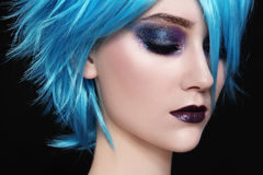 Blue wig. Close-up portrait of yound beautiful woman in blue cosplay wig Royalty Free Stock Image