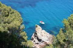 Blue wild creek spain. Blue wild creek tree ocean sea panorama holidays rocks cliff diving escapade  hiking spain Stock Photos