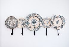 Blue willow china hanger on white wall. Kitchen decoration royalty free stock image