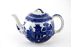 Blue Willow Teapot. Small blue willow pattern tea pot with spout facing left and handle facing right Royalty Free Stock Photos