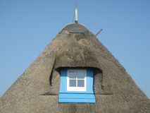 Blue window. In thatched reed roof royalty free stock images