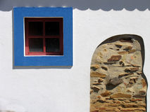 Blue window. Window of a traditional rural house of the south of Portugal. The colors are typical, with white walls (to minimize the heat of the sun) and blue Royalty Free Stock Image