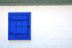 Blue window. Window blinds on traditional house Stock Images