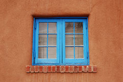 Blue Window in Adobe. Painted blue window frame, part of an adobe home Royalty Free Stock Photography