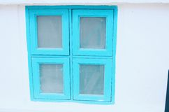 Blue window against clear white wall. In thailand Royalty Free Stock Photo