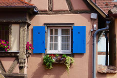 Blue window of a beige house Stock Images