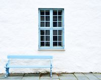 Blue window and bench Stock Images