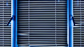 Window blinds. Blue window blinds on a cold winter day. Background of blinds royalty free stock images