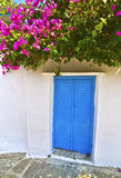 Blue window and bougainvillea at Cyclades Greece Royalty Free Stock Images
