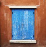 Blue window and brown wall Royalty Free Stock Images