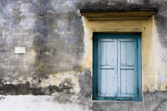 Blue Window. A closed window with blue shutters in Malaysia Stock Photo