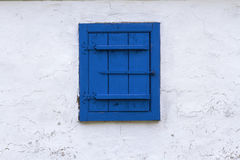 Blue window with closed wooden blind Stock Photo