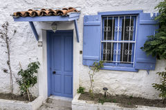 Blue Window and Door. On Stone Wall Royalty Free Stock Image