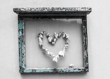 Blue Window frame with a heart made of shells Royalty Free Stock Photography