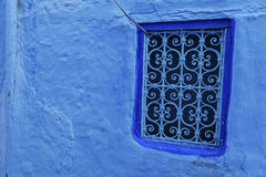 Blue window and grid of chefchaouen Stock Photos