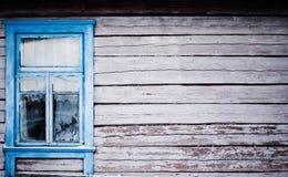 Blue  window on house with peeling paint Stock Image