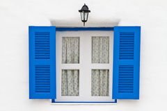 Blue window and lamp on white house Royalty Free Stock Images