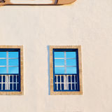 Blue window in morocco africa old construction and brown wall Royalty Free Stock Image