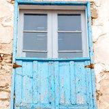 blue window in morocco africa old construction and brown wall   Royalty Free Stock Images