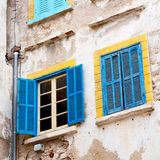 Blue window in morocco africa old construction and brown wall  c Stock Images