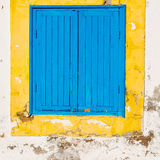 Blue window in morocco africa old construction and brown wall  c Stock Photography