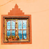 Blue window in morocco africa old construction and brown wall  c Stock Image