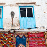 Blue window in morocco africa old construction and brown wall re Royalty Free Stock Photos