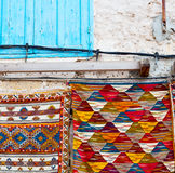 Blue window in morocco    africa old construction and brown wall re Stock Images