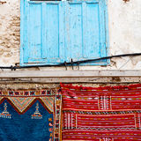 Blue window in morocco africa old construction and brown wall re Royalty Free Stock Images